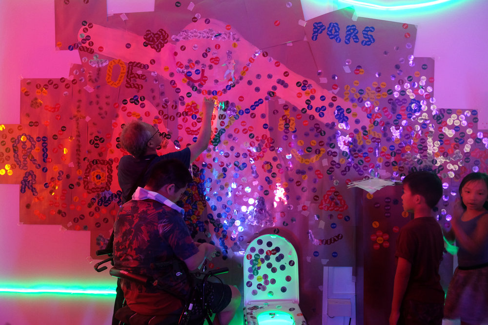 Visitors interacting with part of an installation in JOE.'s ' I'm just an average Joe, babe'.