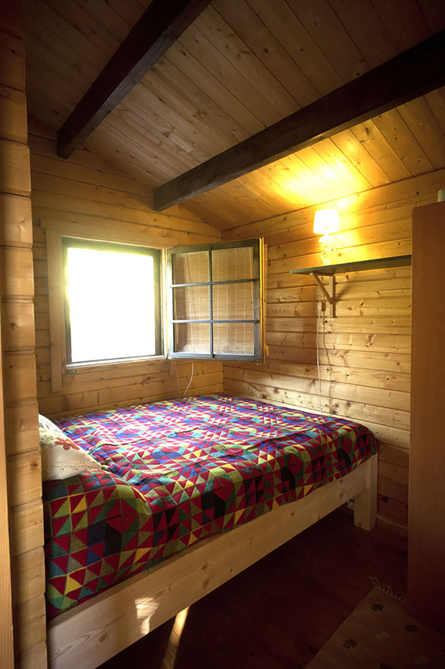 22_Wood Cabin Bedroom.jpeg