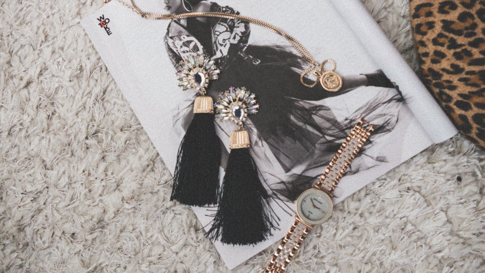Tassel earrings stacked rings, rose gold watch, accessories
