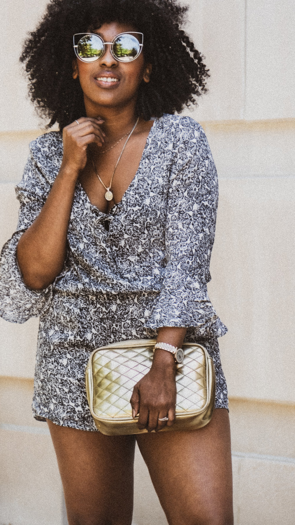 Romper // Sunglasses // Watch //  Necklace/ /    Handba  g