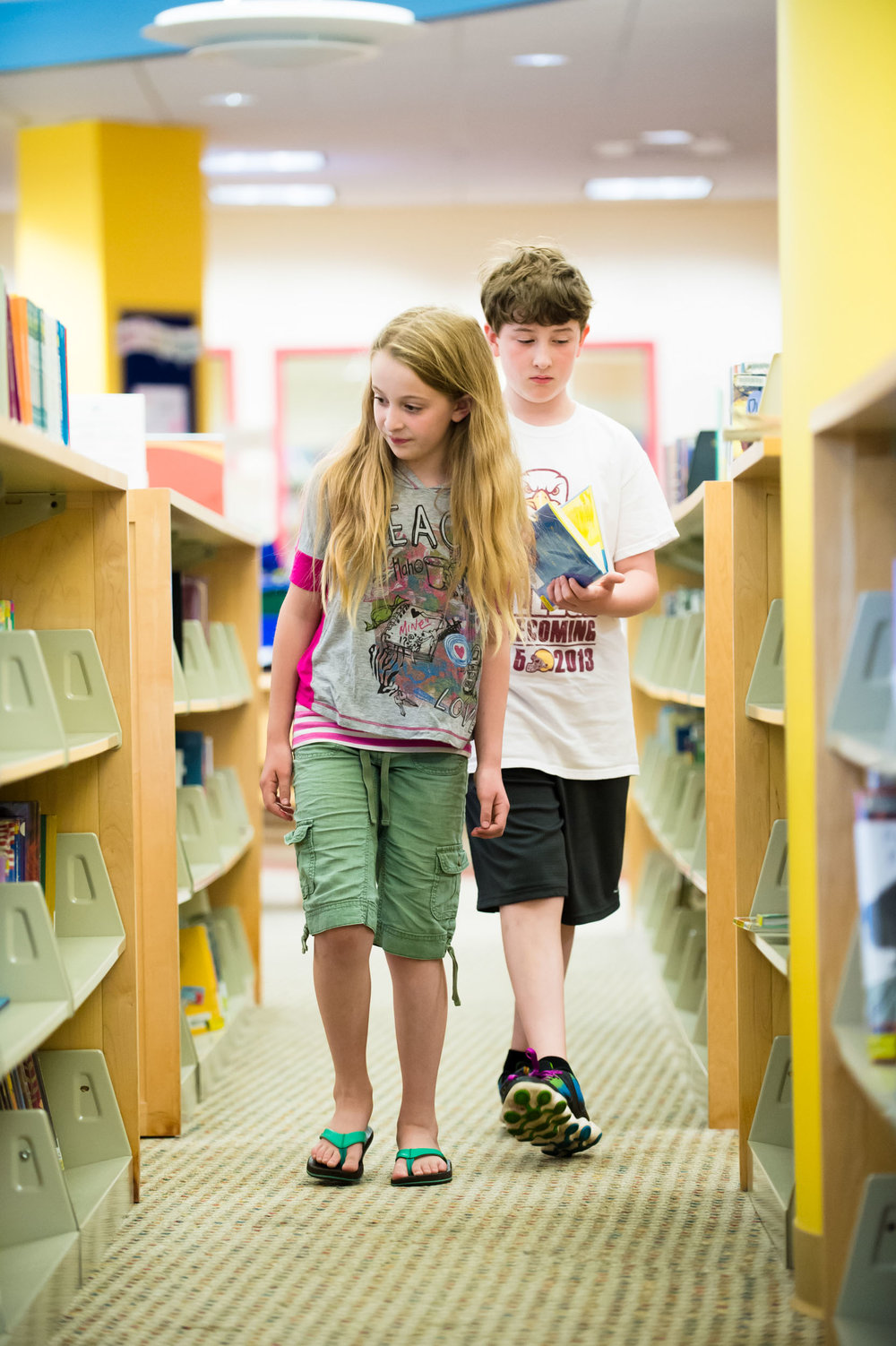 Maura Wayman Photography, Photography, Corporate Photography, stock, stock images, Massachusetts, Boston, Metro West, Stacks, library, kids, books, girl, boy, looking for books,