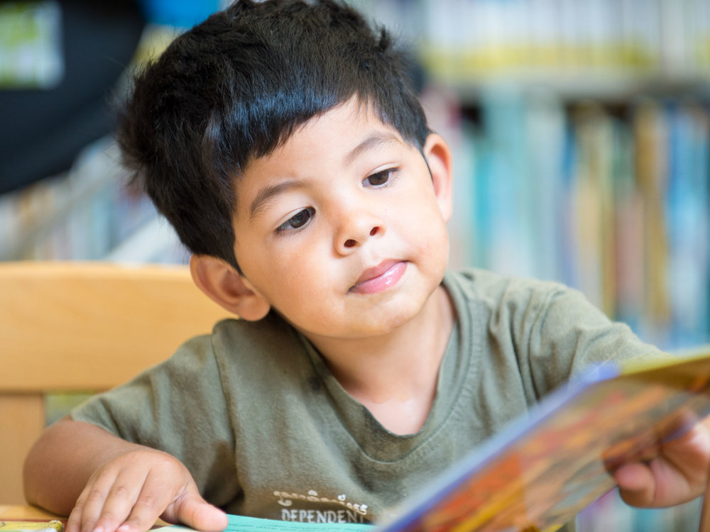 Maura Wayman Photography, Photography, Corporate Photography, stock, stock images, Massachusetts, Boston, Metro West, Stacks, library, kids, books, girl, boy, looking for books, reading book, little boy, green shirt, ethnic, spanish,
