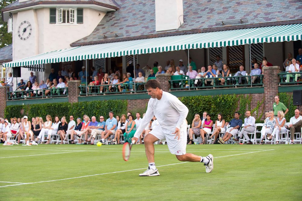 Maura Wayman Photography, Photography, Corporate Photography, Massachusetts, Boston, Metro West, events, Corporate events, Photographer, Functions, Parties, Fundraisers, Longwood Cricket Club, Tennis, Grass court, grass tennis court, player hitting, player hit ball,