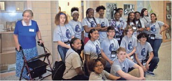 This group from Project GRAD recently helped out at the Knox County Museum of Education. Shown are (rear) museum director Benna Van Vuuren, Tianna Couch-Cox, Keisharra Jones, Gayza Davenport, Jacquise Clegg, Aaliyah Rice, Tirrell Nixon, K'Onie Warren, Breanna Morris, Sharon Sharp and Arianna Smith; (middle) Montasia Queener, Jamija Henry, Nathaniel Moss, Quincy Fields and Adrian Mota; (front) Ahya Moreno and Zane Nelson.  ERVEN WILLIAMS