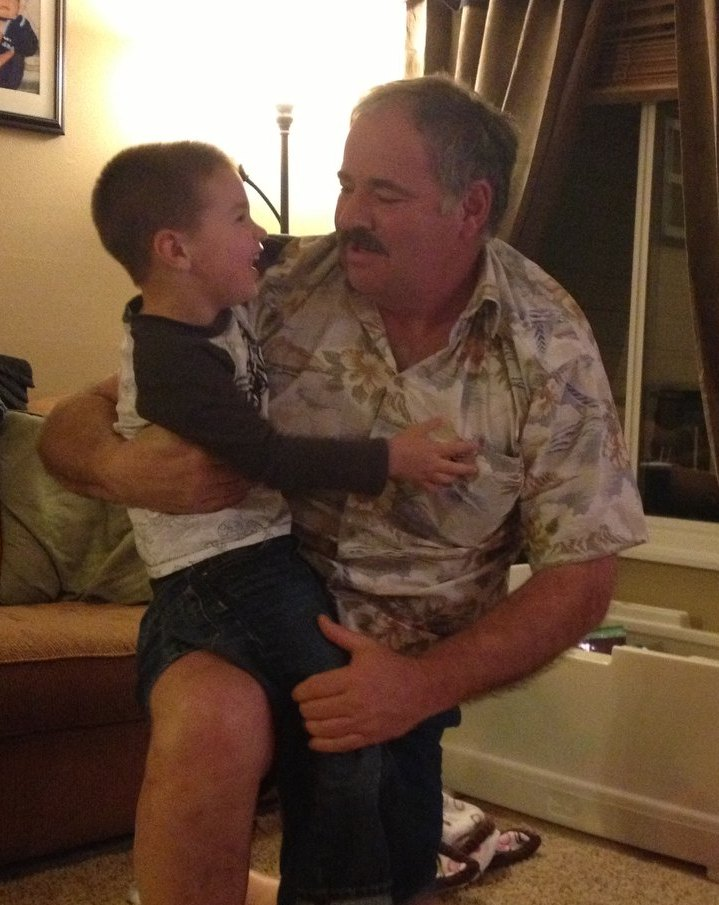 aiden on gramps knee.jpg