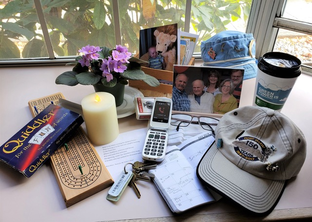 A few of his favorite things: the shrine at his bedside