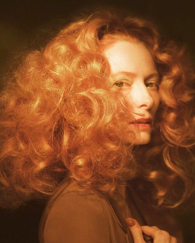 We love strong women, we love artists, we love redheads, and who doesn't love Tilda?