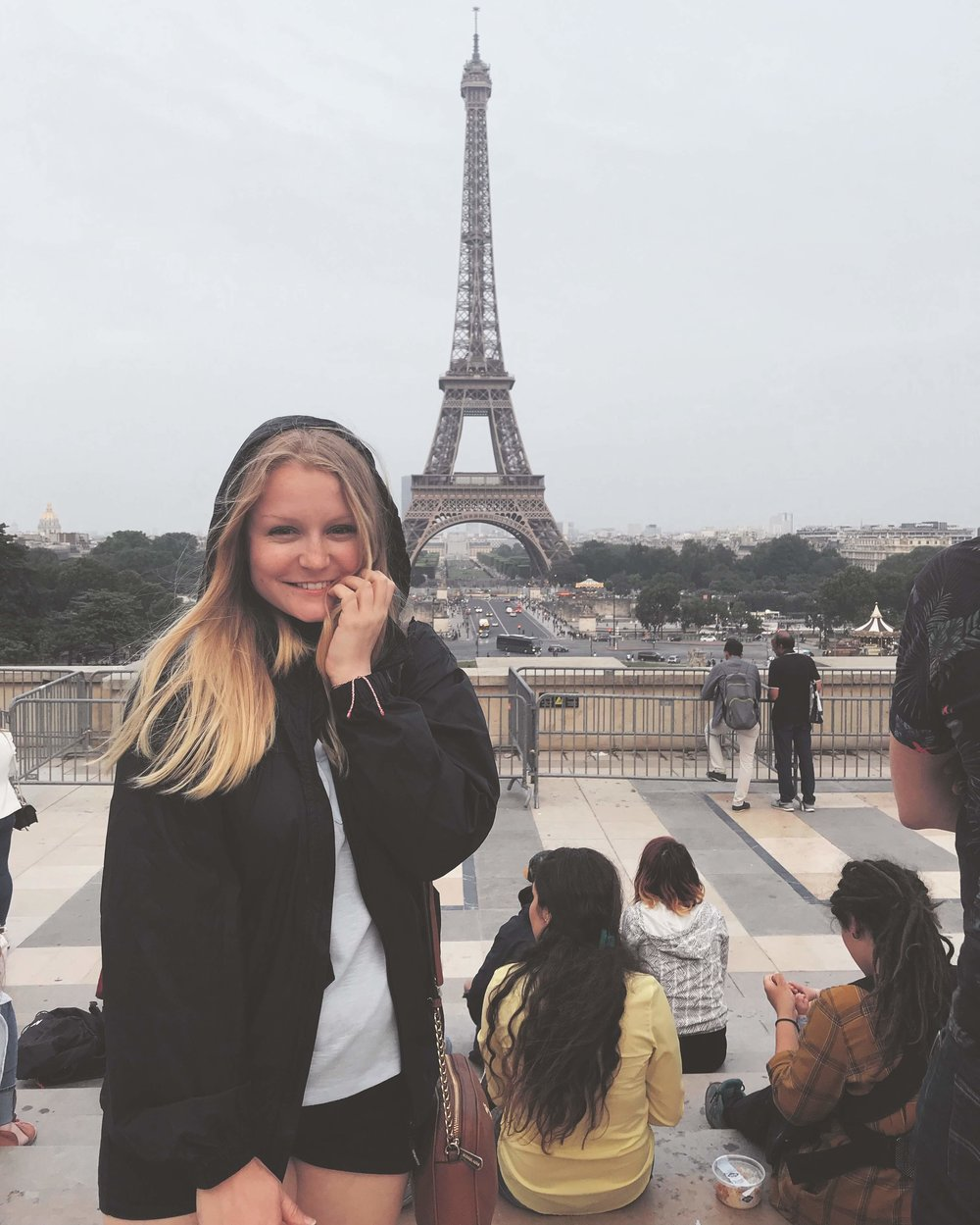 Here Ashton is posing in front of the Eiffel Tower making all of us jealous!