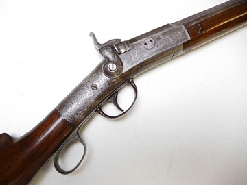 "-  A VERY RARE PERRY PATENT BREACH LOADING FOWLING GUN IN 12 BORE. THIS IS THE ONLY EXAMPLE WE HAVE BEEN ABLE TO LOCATE, ALL OTHERS ARE CONFIGURED AS RIFLES. THIS ITEM HAS A 34"" BARREL WHICH TRANSITIONS FROM OCTAGONAL TO ROUND.THE ACTION IS UNIQUE IN THAT THERE IS A TUBULAR MAGAZINE LOCATED IN THE BUTT STOCK THAT AUTOMATICALLY FEEDS A PERCUSSION CAP ONTO THE NIPPLE WHEN THE LEVER IS COCKED, THE BREACH IS THEN OPEN AND ACCEPTS A PAPER CARTRIDGE WITH POWDER AND SHOT. THE TOP OF THE BREECH BLOCK IS MARKED ""PERRY PATENT ARM CO. / NEWARK N.J."" SERIAL #550 IS MARKED BOTH ON THE TOP OF THE REC... (read more)"