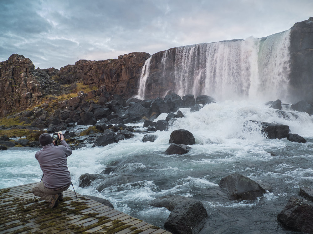 Photographing a waterfall in Iceland, 2016. (Photo by Alison Reaves)