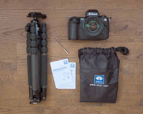 Sirui T-025x Carbon Fiber Tripod, C-10 Ball Head, Hex Key, Manuals, and Carrying Case (which doubles as a small backpack).