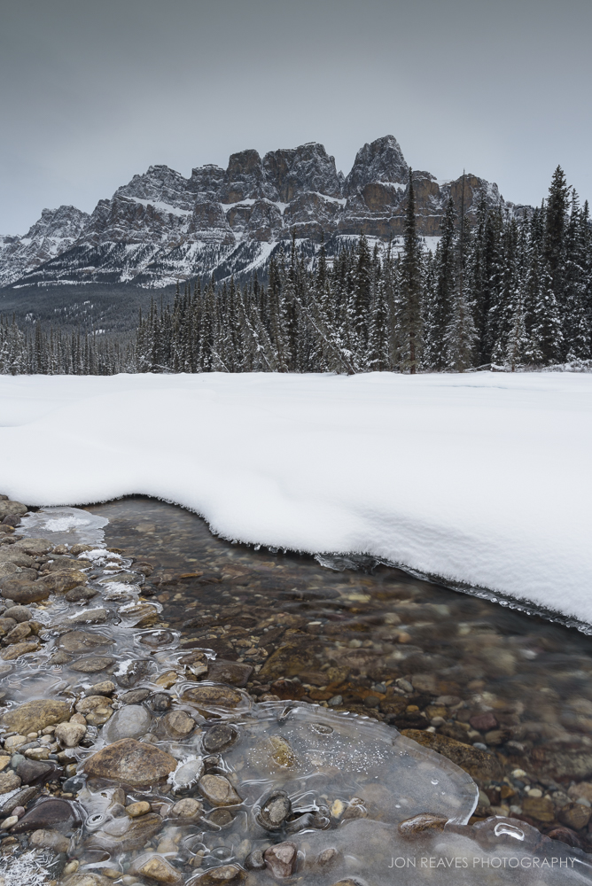 Snow and ice on the Bow River with Castle Mountain, Banff National Park