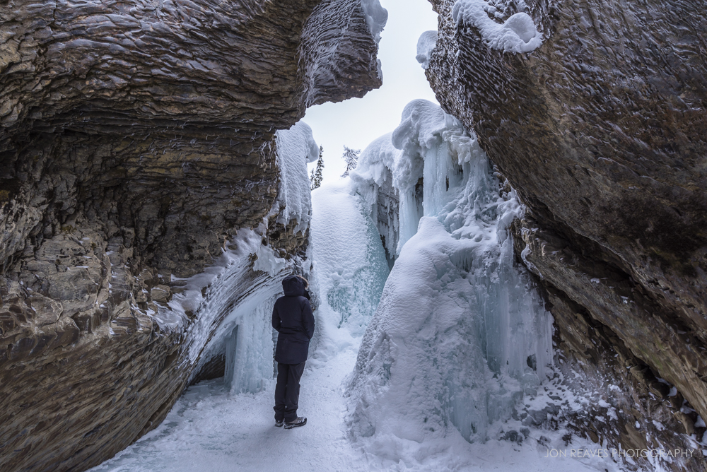 Alison inspecting a frozen waterfall, Natural Bridge, Yoho National Park