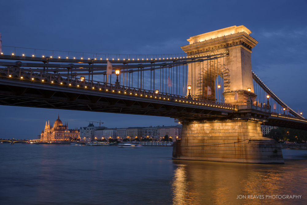 The Chain Bridge and Hungarian Parliament by the Danube at twilight.