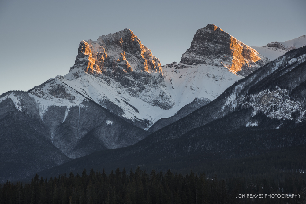 One of the few views of Three Sisters (two of the three) in Canmore free of power lines. Shot from a bridge in town centre.