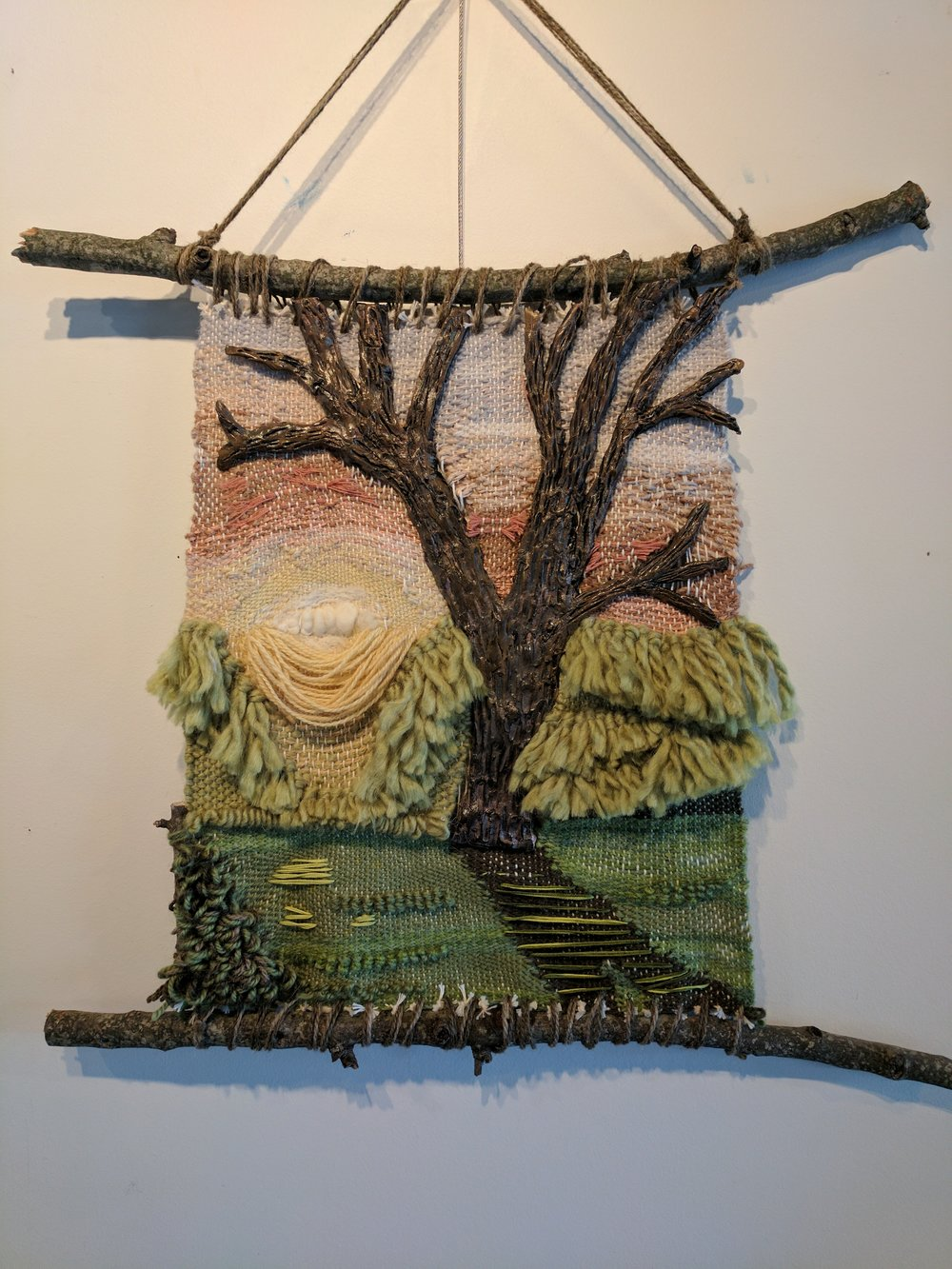 "The Morning Tree     Wool and mixed fibers, paper clay, branches, acrylic  aproximately 13""x16"""