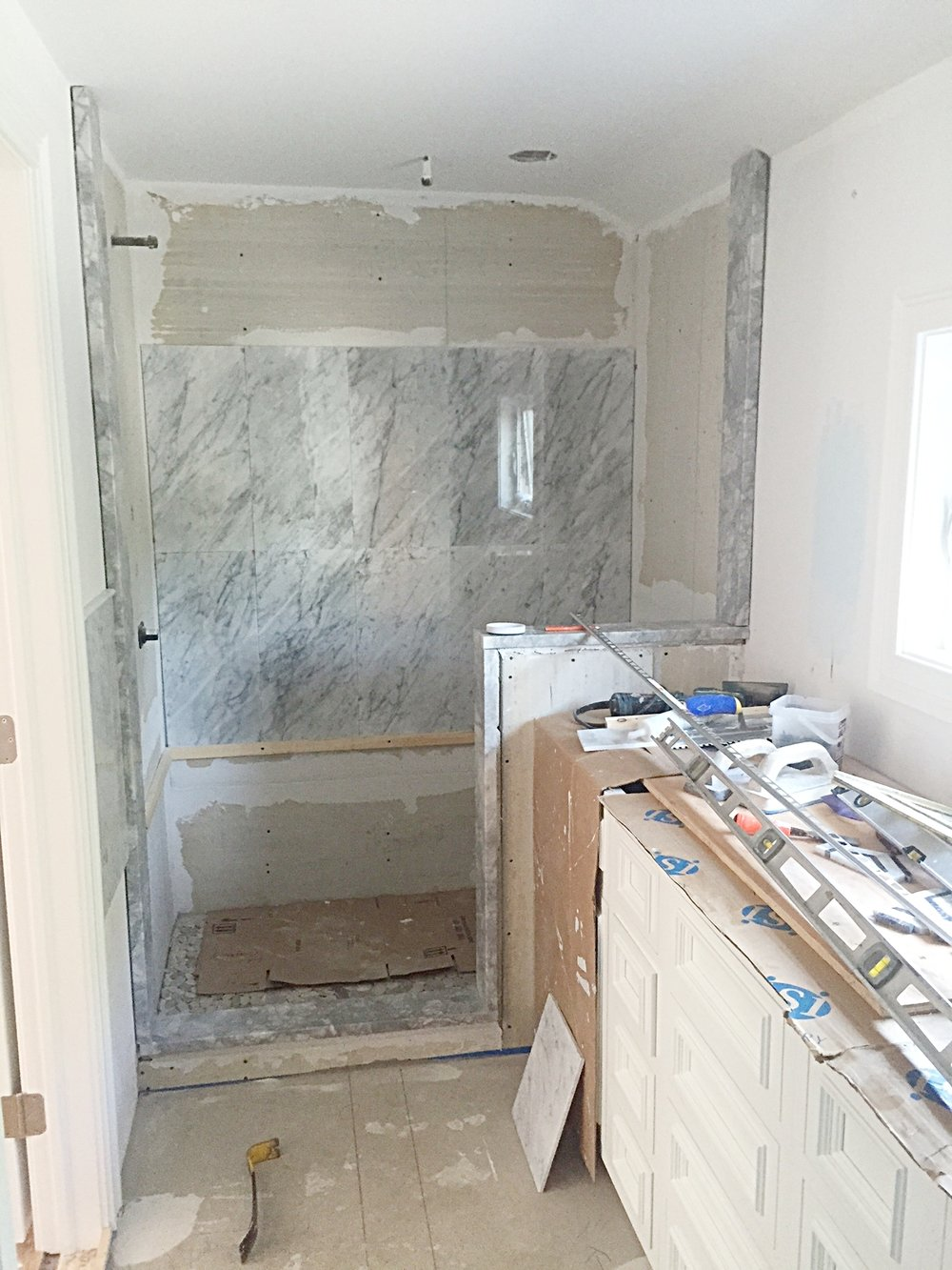 Cabinets are in, marble being placed