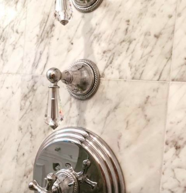 Crystal knobs against marble with a chrome finish