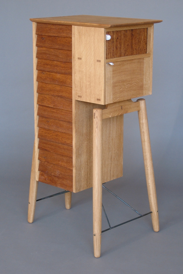 David Gates, Silo, 2007. Photo Credit David Gates. Quarter-sawn European Oak, Cedar of Lebanon, Eastern Red Cedar, Steel, vitreous enamel handles on the fall-flap and tambour were made by Helen Carnac, 115 cm high.