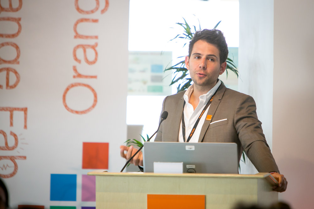 Orange Fab Lead Guillaume Payan delivering the welcome address.