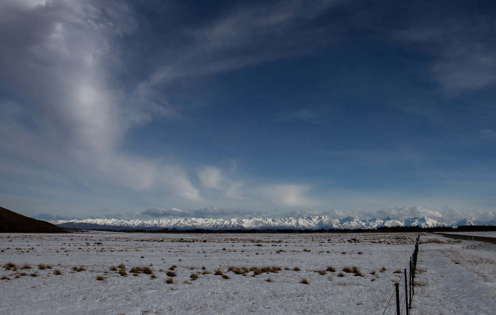 Heading to Lake Tekapo, Southern Alps in the distance