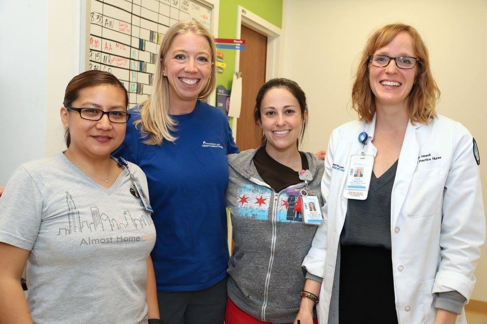 Carrie Jones (blue shirt) at Lurie Children's. Photo Credit: Jan Terry, Lurie Children's Hospital