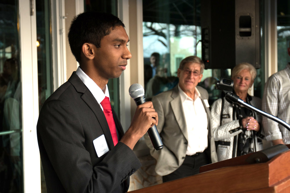 Josh Kalapala addresses the crowd at Taste of Timothy
