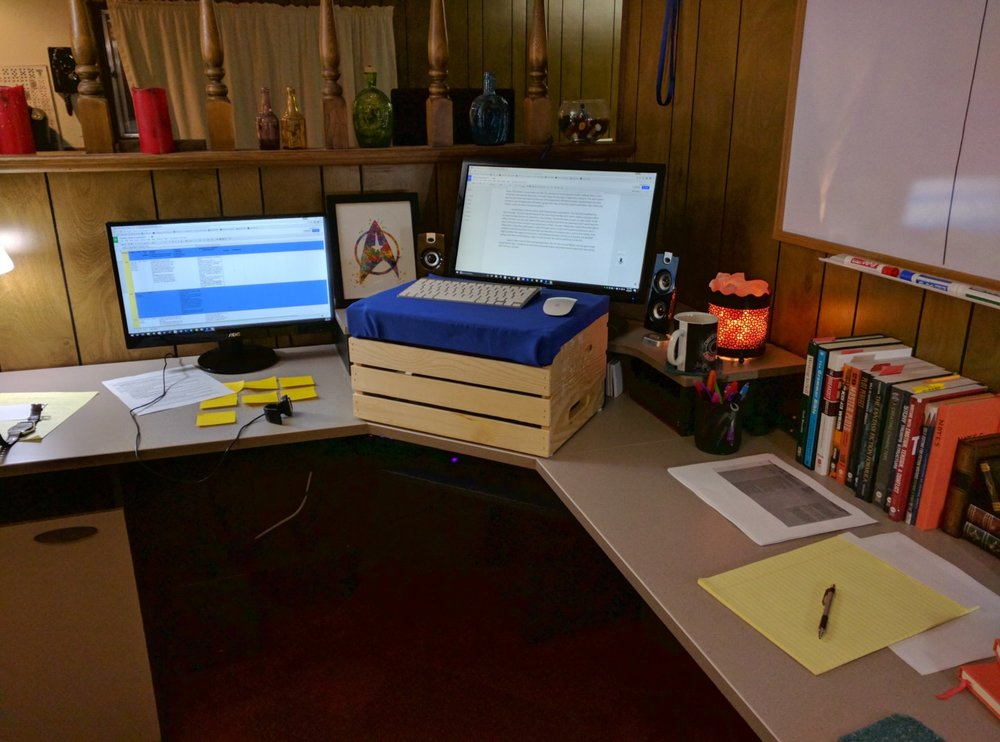 Desk space with cheap standing desk solution.
