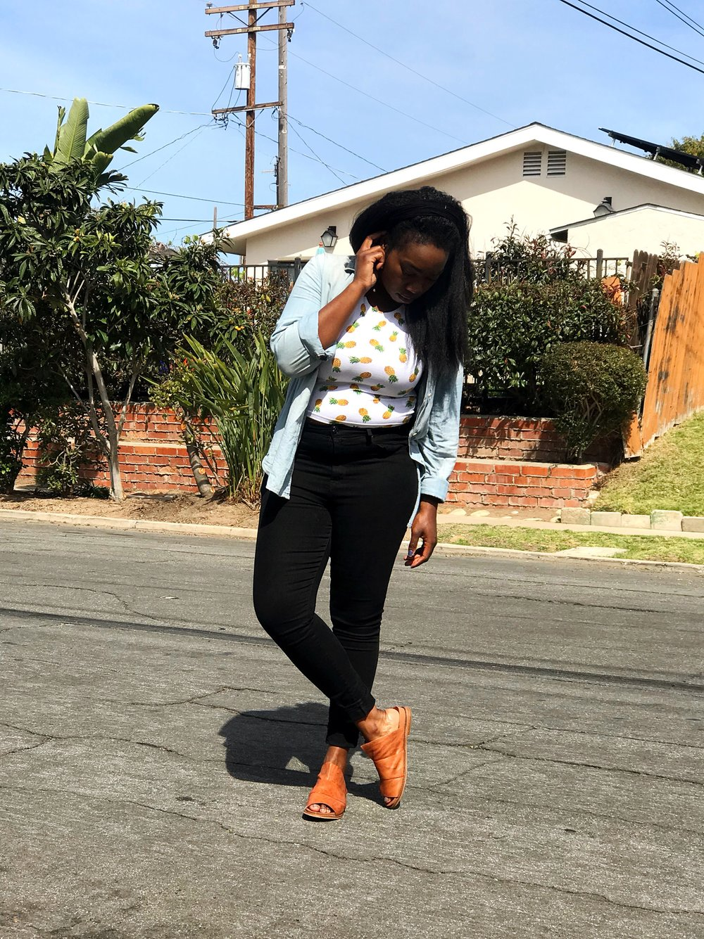 Image: Femi wearing Kelsi Dagger sandals in San Diego, California