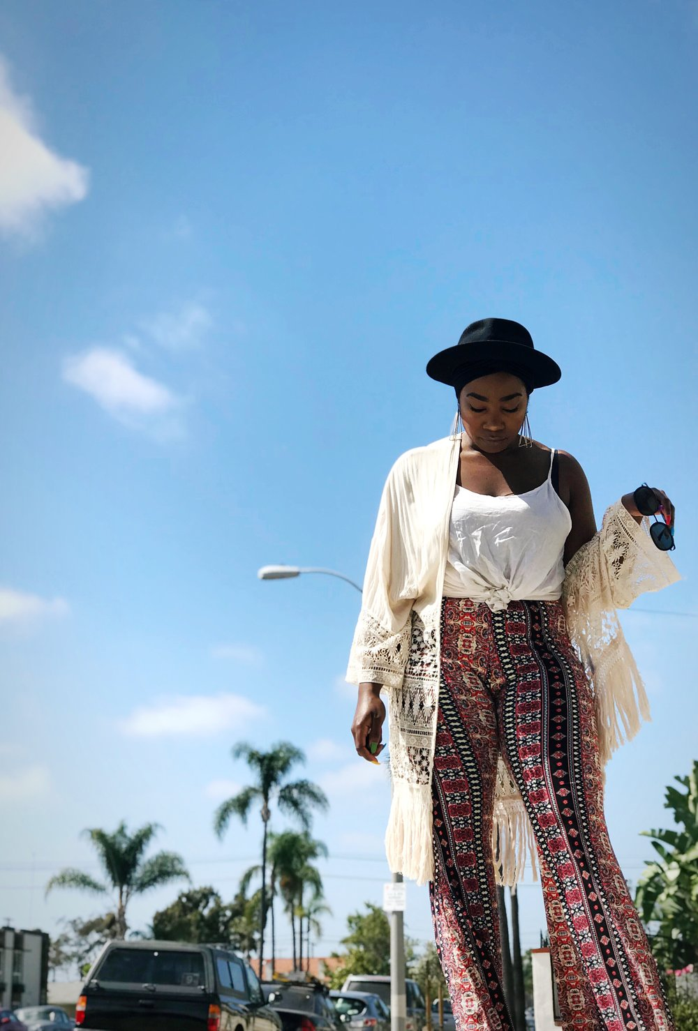 Image: Femi wearing music festival clothing outside in North Park