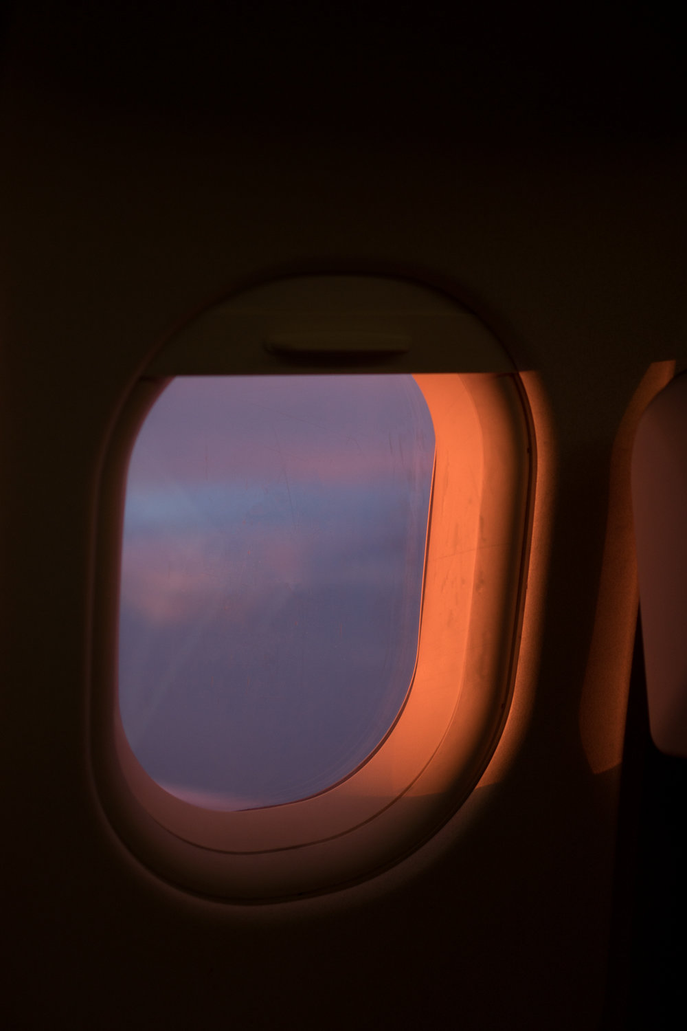 Sunset Airplane Window View. Photograph by Sarah Natsumi Moore