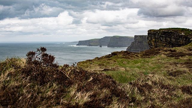 Looking north over the Cliffs of Moher, Ireland. By far one of the most breathtaking, wild, and harsh environments I've seen. If you ever have the chance to go here, start the walk from the most southern point and you'll have most of the hike to yourself. Trust me, it's worth it #tourbusesaretheworst . . . . . . #cliffsofmoher #Liscannor #éire #ireland #wild #harsh #northatlantic #blue #travelphotography #travel #adventure #windyaf #backpacking #eurotrippin #quiet #windburnt