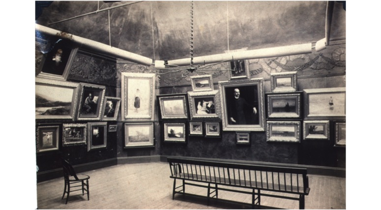 "An early exhibition at the Providence Art Club, about 1890, founded in 1880 to stimulate ""art culture"" in Providence, RI. The Club utilizes the same gallery space for exhibitions today."