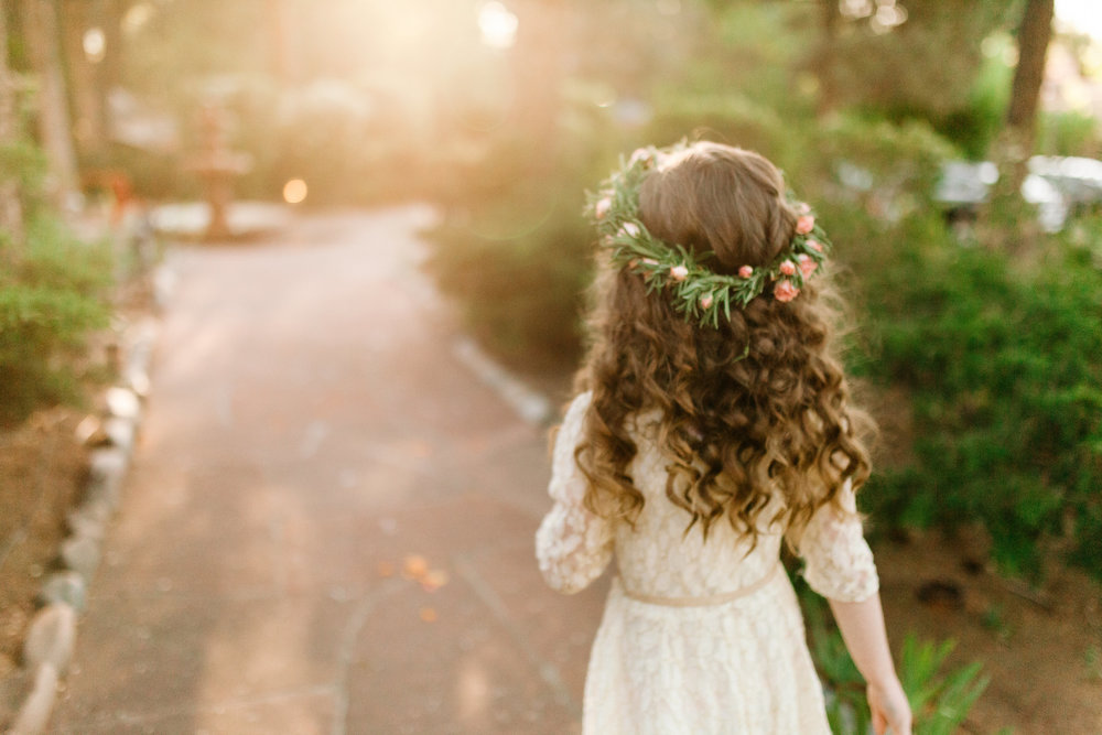 My 8-year-old niece, Savannah, after finishing her flower girl duties (photo by Joni Bilderback; floral crown by Floral Designs by Jessi)