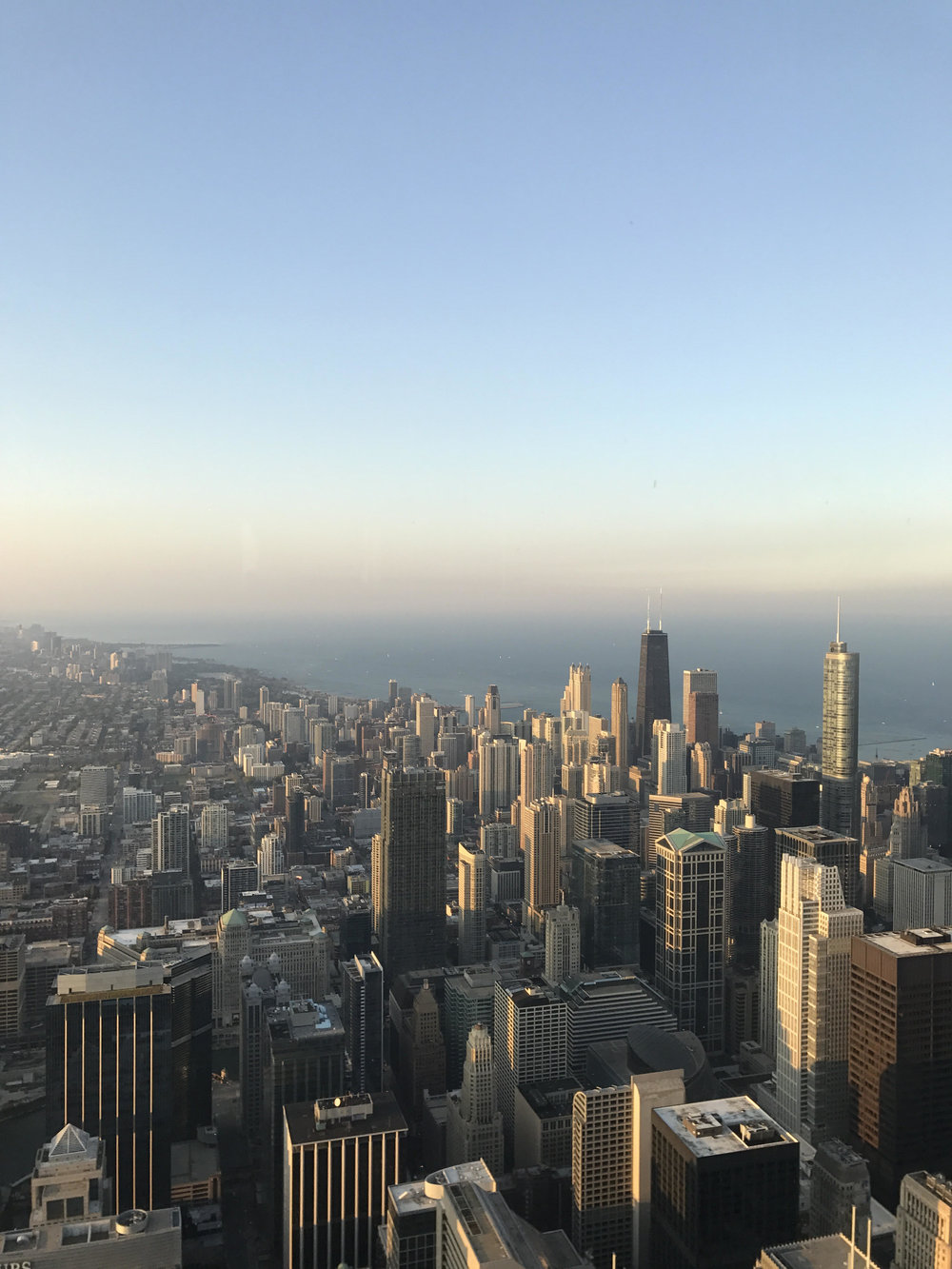 Highest Point in Chicago. Check. - Sears Tower (Willis Tower) standing at 1,729 feet tall. And you better bet that I walked out to the Skydeck ledge. Also check out the shadow of the building pointing into Lake Michigan in the picture below. This was a fantastic start to our anniversary weekend!