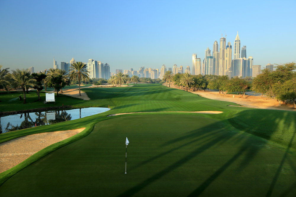 The impeccable Majlis Course at Emirates Golf Club with views of the towers beyond.
