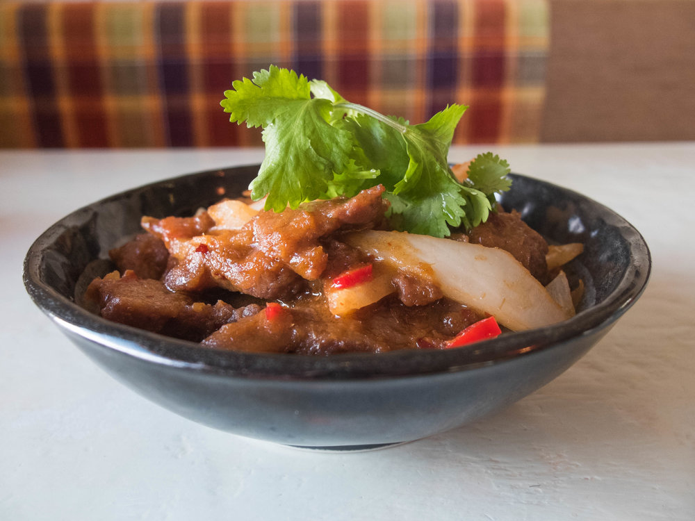 Fried beef slices in a thick sauce