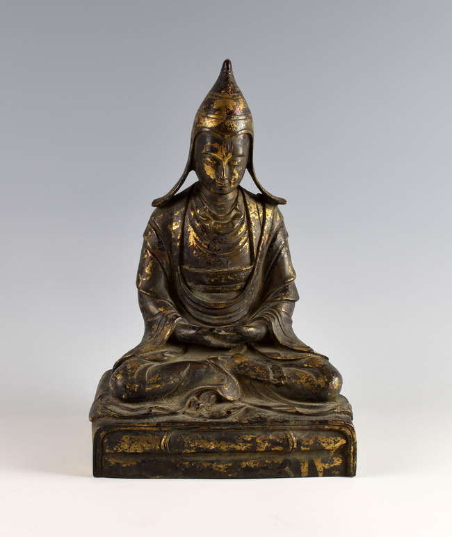 A highly Sino-Tebetan cast bronze Buddha with great patina is estimated at £800-1,200.