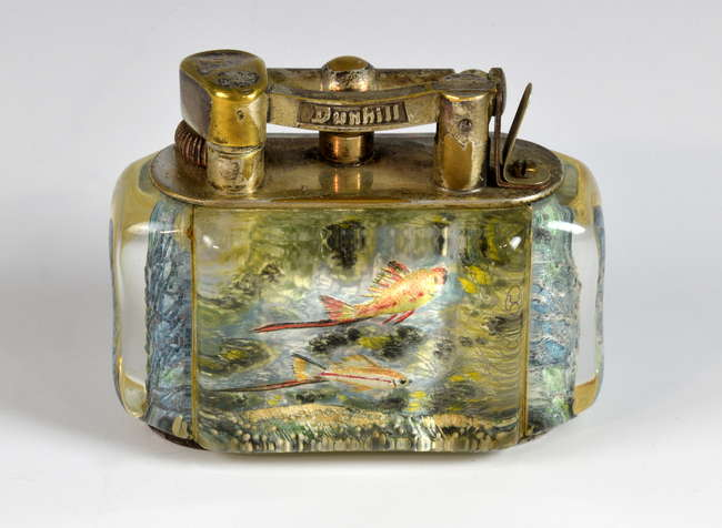 A Dunhill Aquarium table lighter estimated at £800-1,200