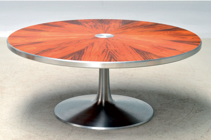 Late 1960s coffee table with mirror-image cut rosewood top, aluminium edge moulding, centre and trumpet base. Designed for Cado