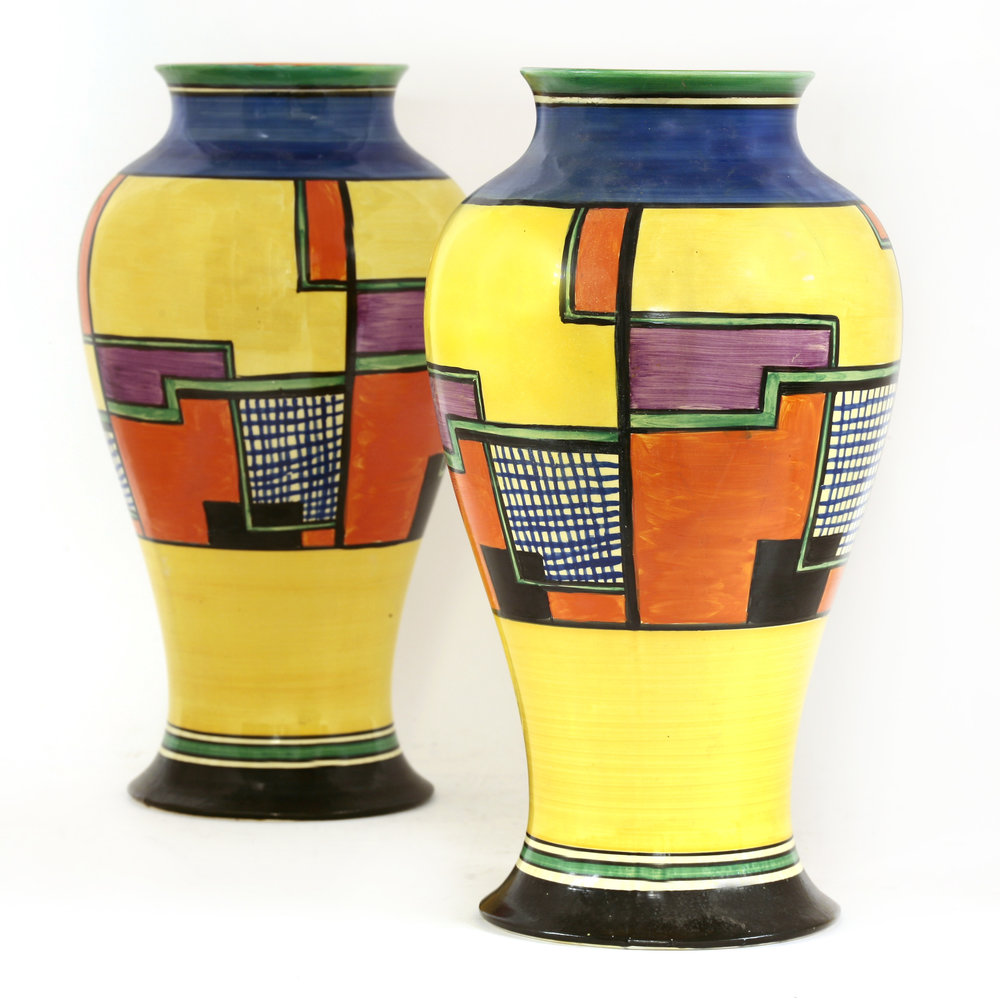 A pair of Clarice Cliff vases in the so-called Football pattern are expected to bring £2000-3000.