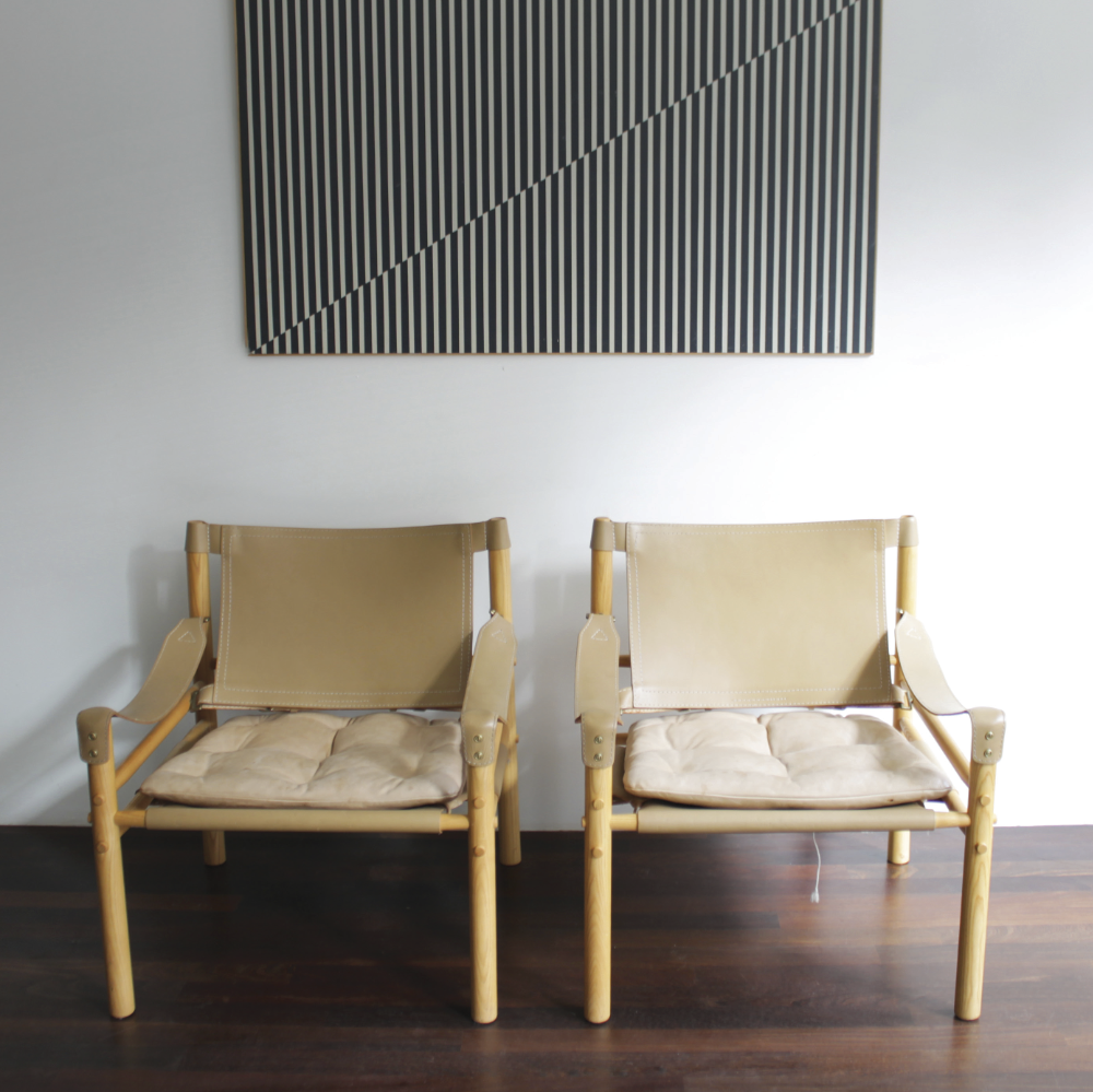 SIROCCO: Made in 1964 and inspired by the Danish Kaare Klint's Safari leather chairs (which in turn took inspiration from an English campaign chair Klint had seen in an African picture!) As with original campaign furniture, it can be easily disassembled if needs be. Note the stringing to the base that holds the sling seat in position, supporting a loose cushion (below).