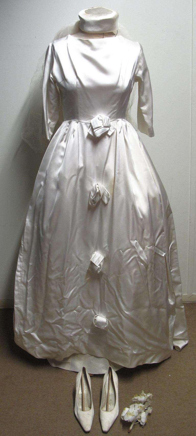 Lot 58 - 1960s Jean Varon vintage cream satin wedding dress with accessories. Estimate £60-80