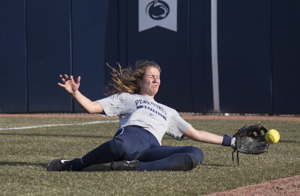 Gianna Arrizurrita slides to catch a pop up during a practice session in Nittany Lion Softball Park on Tuesday, Feb.21, 2017.