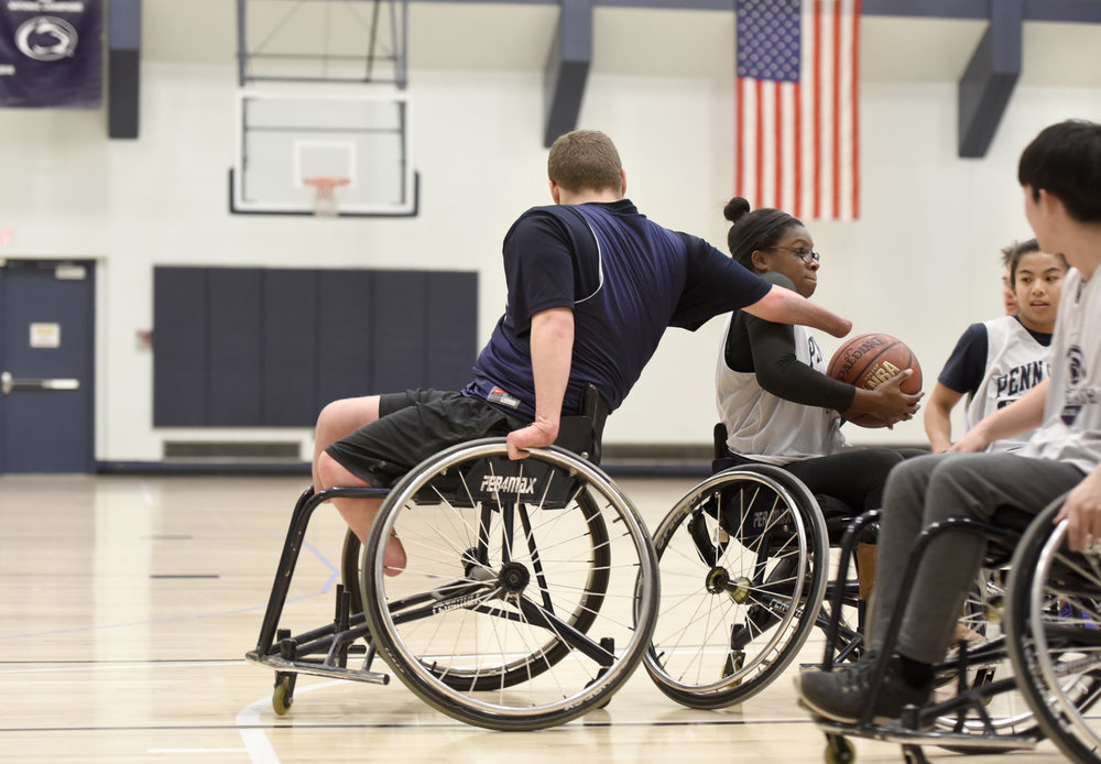 Sean Brame plays defense during an Ability Athletes wheelchair basketball game at the White Building at Penn State University.