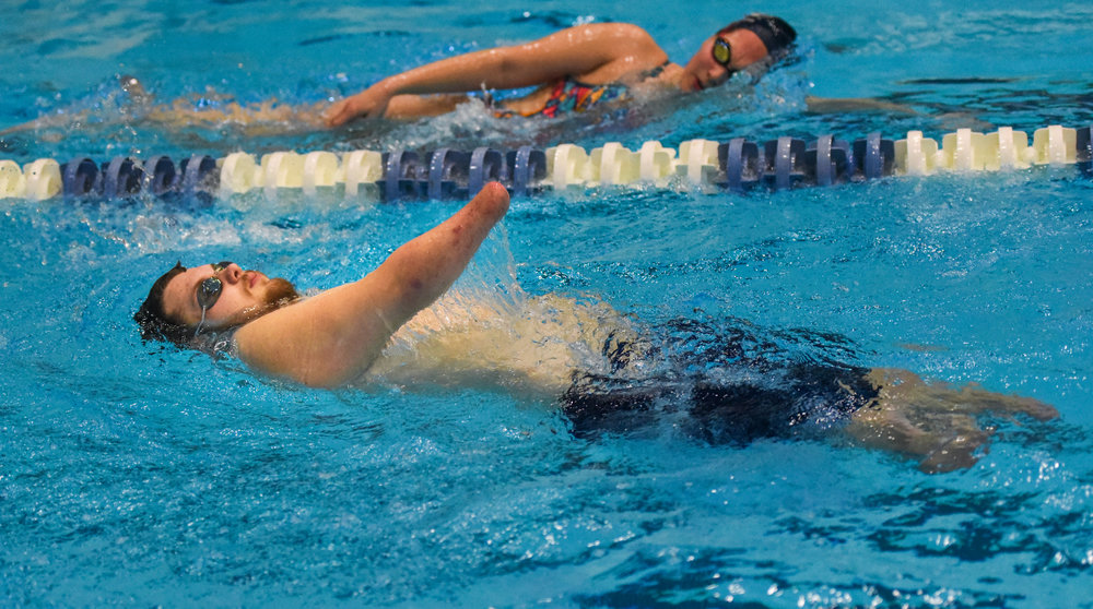 Sean Brame trains at the Penn State Natatorium. He is the only amputee swimmer in the pool. He's shown here swimming laps with Nittany Lion Aquatic Club (MANLAC). Brame trains with the club twice a week.