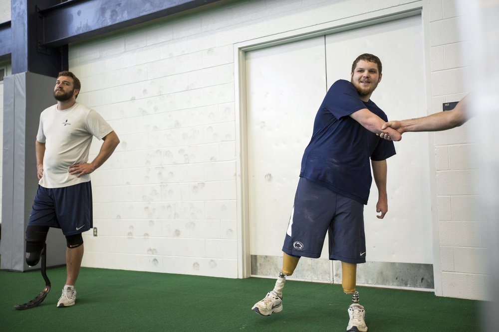 Brame greets a friend as he works out with Max Rohn at the Penn State Multi-Sport Facility.