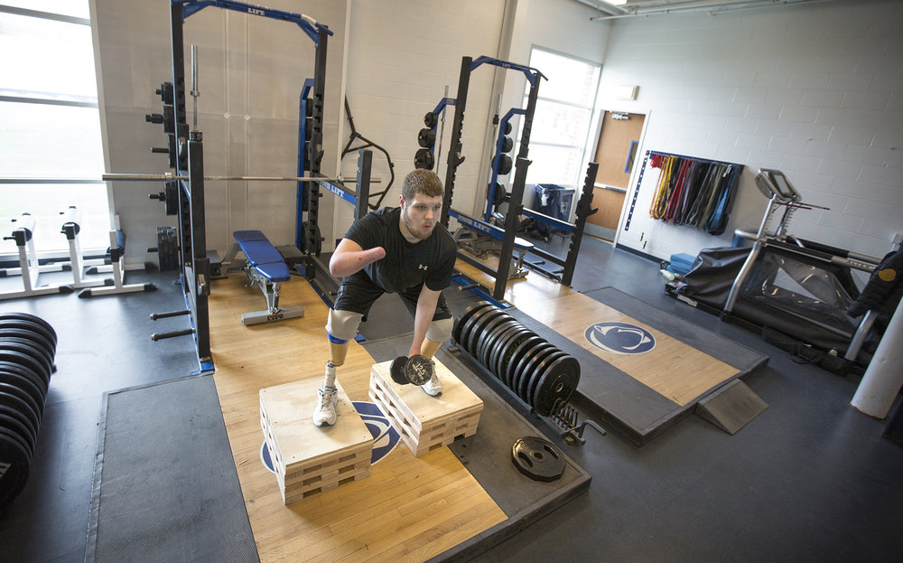 Sean Brame squats as he concentrates on a core strength training during a weight lifting session on February 3, 2017 at the Penn State Multi-Sport Facility. He trains two hours a day, three times a week. The weight training is crucial to his development towards his goal of competing in the Paralympics.