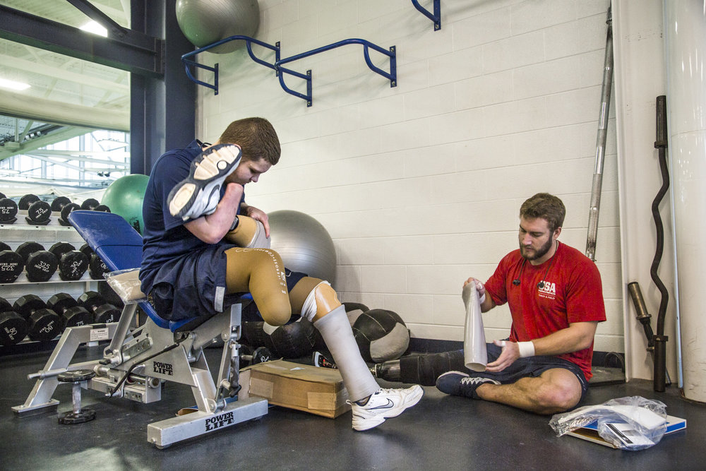 Brame sits with fellow Penn State ability athlete Max Rohn before a weight training session at the Penn State Multi-Sport Facility.