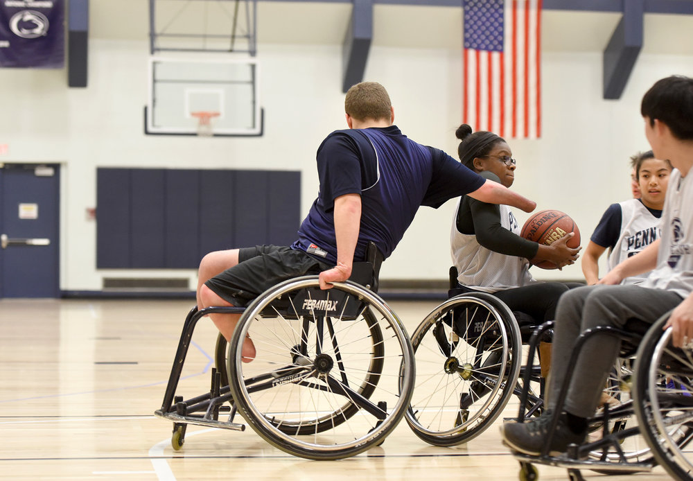 Sean Brame plays defense during an Ability Athletes wheelchair basketball game at the White Building.